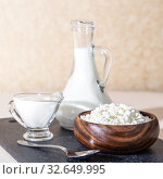 Купить «Food is a source of calcium, magnesium, protein, fats, carbohydrates, balanced diet. Fresh dairy products on the table: cottage cheese, sour cream, milk, contain casein, albumin, globulin, free lactose», фото № 32649995, снято 14 декабря 2019 г. (c) Светлана Евграфова / Фотобанк Лори