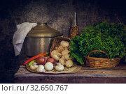 Vegetables on a vintage wooden chest. Стоковое фото, фотограф Татьяна Ляпи / Фотобанк Лори