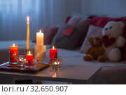 Burning candles on white table in interior. Valentines day concept. Стоковое фото, фотограф Майя Крученкова / Фотобанк Лори