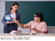 Купить «Old female teacher and male student in the classroom», фото № 32666523, снято 11 февраля 2019 г. (c) Elnur / Фотобанк Лори