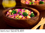Купить «Fresh red cabbage, chickpea, carrot and broccoli salad in wooden bowls, photographed with natural light (Selective Focus, Focus in the middle of the image)», фото № 32673491, снято 5 апреля 2020 г. (c) easy Fotostock / Фотобанк Лори