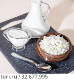 Купить «Food is a source of calcium, magnesium, protein, fats, carbohydrates, balanced diet. Dairy products for breakfast: cottage cheese, sour cream, milk, contain casein, albumin, globulin, free lactose», фото № 32677995, снято 14 декабря 2019 г. (c) Светлана Евграфова / Фотобанк Лори