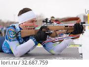 Купить «Sportsman biathlete aiming rifle shooting prone position. Biathlete Andrey Krutov Khanty-Mansiysk in shooting range. Junior biathlon competitions East of Cup», фото № 32687759, снято 12 апреля 2019 г. (c) А. А. Пирагис / Фотобанк Лори