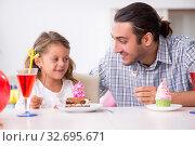 Купить «Father celebrating birthday with his daughter», фото № 32695671, снято 6 августа 2019 г. (c) Elnur / Фотобанк Лори