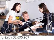 Купить «Students and teacher discussing details of architectural model», фото № 32695967, снято 8 ноября 2018 г. (c) Яков Филимонов / Фотобанк Лори