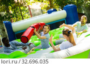 Купить «Funny friends playing on an inflatable trampoline in an amusement park», фото № 32696035, снято 17 февраля 2020 г. (c) Яков Филимонов / Фотобанк Лори