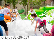 Купить «Game of funny friends in soap suds on an inflatable trampoline», фото № 32696059, снято 17 февраля 2020 г. (c) Яков Филимонов / Фотобанк Лори