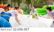 Купить «Adults collecting balls in inflatable pool with foam», фото № 32696067, снято 4 апреля 2020 г. (c) Яков Филимонов / Фотобанк Лори