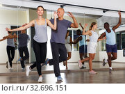 Купить «People practicing dance movements in class», фото № 32696151, снято 30 июля 2018 г. (c) Яков Филимонов / Фотобанк Лори