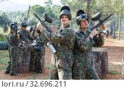 Купить «Two men in camouflage with guns ready for playing paintball with friends», фото № 32696211, снято 22 сентября 2018 г. (c) Яков Филимонов / Фотобанк Лори