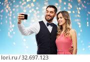 Купить «happy couple taking selfie by smartphone», фото № 32697123, снято 30 ноября 2018 г. (c) Syda Productions / Фотобанк Лори