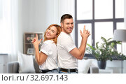Купить «couple in white t-shirts shirts making gun gesture», фото № 32697143, снято 6 октября 2019 г. (c) Syda Productions / Фотобанк Лори