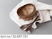 Купить «close up of coconut bowl, wooden spoon and fork», фото № 32697151, снято 3 мая 2019 г. (c) Syda Productions / Фотобанк Лори