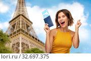 Купить «happy woman with air ticket over eiffel tower», фото № 32697375, снято 30 сентября 2019 г. (c) Syda Productions / Фотобанк Лори