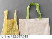 Купить «plastic bag and reusable tote for food shopping», фото № 32697615, снято 3 мая 2019 г. (c) Syda Productions / Фотобанк Лори