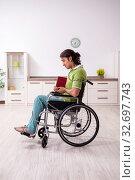 Купить «Young male invalid in wheel-chair suffering at home», фото № 32697743, снято 23 июля 2019 г. (c) Elnur / Фотобанк Лори