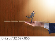 Businessman in career support concept. Стоковое фото, фотограф Elnur / Фотобанк Лори