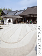 Sand garden with stripes Ginshadan is next to wooden temple Jisho-ji. It is in the Ginkakuji or the Silver Pavilion. The Ginshadan represents one of the Fuji five lakes. Kyoto (2013 год). Редакционное фото, фотограф Кекяляйнен Андрей / Фотобанк Лори