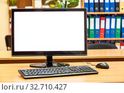 PC monitor with cutout screen standing on office table with keyboard and mouse, nobody. Стоковое фото, фотограф Кекяляйнен Андрей / Фотобанк Лори