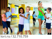 Children dancing together slow ballroom dances in pairs in chore. Стоковое фото, фотограф Яков Филимонов / Фотобанк Лори