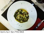 Купить «Image of stewed spinach with ham, dish of Catalan cuisine», фото № 32710943, снято 16 июля 2019 г. (c) Яков Филимонов / Фотобанк Лори