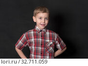 Купить «Boy on a black background», фото № 32711059, снято 22 февраля 2015 г. (c) Argument / Фотобанк Лори