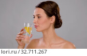woman drinking fresh water with lemon slices. Стоковое видео, видеограф Syda Productions / Фотобанк Лори