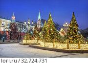 Купить «Новогодние ёлочки на Манежной площади. Москва. Christmas trees and houses on Manezhnaya Square», фото № 32724731, снято 15 декабря 2019 г. (c) Baturina Yuliya / Фотобанк Лори