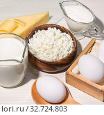 Купить «Food is a source of calcium, magnesium, protein, fats, carbohydrates, balanced diet. Dairy products on the table: cottage cheese, sour cream, milk, cheese, chicken egg, contain casein, albumin, globulin, free lactose», фото № 32724803, снято 14 декабря 2019 г. (c) Светлана Евграфова / Фотобанк Лори