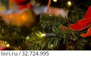 Купить «artificial christmas tree decorated with red bow», видеоролик № 32724995, снято 16 декабря 2019 г. (c) Syda Productions / Фотобанк Лори