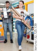 Купить «Young woman are demonstration variety instruments for repair house», фото № 32725139, снято 17 мая 2018 г. (c) Яков Филимонов / Фотобанк Лори