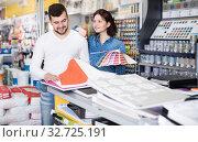 Купить «Couple examining various decorative materials», фото № 32725191, снято 9 марта 2017 г. (c) Яков Филимонов / Фотобанк Лори