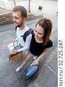 Купить «Couple going the historic city center», фото № 32725247, снято 25 мая 2017 г. (c) Яков Филимонов / Фотобанк Лори