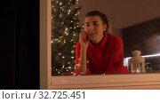 Купить «happy woman drinking coffee on christmas at home», видеоролик № 32725451, снято 16 декабря 2019 г. (c) Syda Productions / Фотобанк Лори