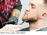 Купить «Beard care. man while trimming his facial hair cut at the barbershop», фото № 32725907, снято 28 октября 2017 г. (c) Дмитрий Калиновский / Фотобанк Лори