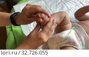 Купить «Feet massage of infant girl. Close up view of leg and therapist hands», видеоролик № 32726055, снято 2 октября 2019 г. (c) Кекяляйнен Андрей / Фотобанк Лори