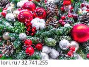 Купить «Праздничный новогодний натюрморт из разноцветных стеклянных елочных шаров и искусственных зеленых еловых веток и шишек», фото № 32741255, снято 13 декабря 2019 г. (c) Владимир Сергеев / Фотобанк Лори