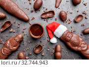 Delicious festive Christmas chocolate and sweets on rustic background. Стоковое фото, фотограф Zoonar.com/Tomas Anderson / easy Fotostock / Фотобанк Лори