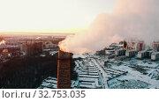 Купить «Industrial theme - deep smoke coming out of a manufacturing pipe - atmospheric pollution», видеоролик № 32753035, снято 21 февраля 2020 г. (c) Константин Шишкин / Фотобанк Лори