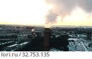 Купить «Pollution - a big industrial pipe pollutes the air in the city», видеоролик № 32753135, снято 21 февраля 2020 г. (c) Константин Шишкин / Фотобанк Лори