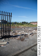 Купить «Great Britain, Northern Ireland, Belfast - Protestant part of West Belfast - neglected, burnt square after the bonfire of Orangemens Day, behind the Peace Wall», фото № 32753851, снято 14 июля 2019 г. (c) Caro Photoagency / Фотобанк Лори