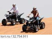Купить «Dubai, United Arab Emirates, teenagers drive on quads through the desert», фото № 32754911, снято 30 марта 2018 г. (c) Caro Photoagency / Фотобанк Лори