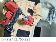Купить «electrician service. Installer nailing tube holder for cable conduit», фото № 32755223, снято 11 декабря 2019 г. (c) Дмитрий Калиновский / Фотобанк Лори