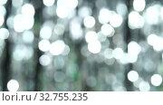 Купить «Abstract shiny background with silver defocused bokeh. Beautiful dynamic background in shining lights and sparkling particles. Festive mood. Christmas or holiday theme», видеоролик № 32755235, снято 17 февраля 2020 г. (c) Dmitry Domashenko / Фотобанк Лори