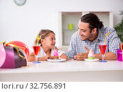 Купить «Father celebrating birthday with his daughter», фото № 32756891, снято 6 августа 2019 г. (c) Elnur / Фотобанк Лори