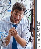 Купить «Electrician trying to untangle wires in repair concept», фото № 32757827, снято 7 июля 2017 г. (c) Elnur / Фотобанк Лори