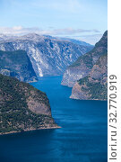 Aurlandsfjord is the 29-kilometre (18 mi) long fjord in Sogn og Fjordane county. Norway. Seen north-northwest from Stegastein (2018 год). Стоковое фото, фотограф Кекяляйнен Андрей / Фотобанк Лори