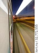Купить «View of train at full speed crossing the station», фото № 32772555, снято 6 июля 2020 г. (c) easy Fotostock / Фотобанк Лори