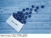 Ripe cherries dropped from white envelope. Стоковое фото, фотограф Kira_Yan / Фотобанк Лори