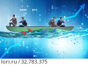 Disagreement concept with businessmen rowing in different direct. Стоковое фото, фотограф Elnur / Фотобанк Лори